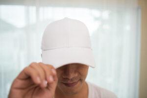 Man wearing white cap