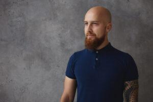 Bald man in navy shirt