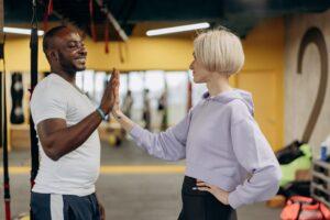 PT high-fiving a client after workout