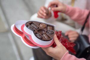Couple sharing chocolate